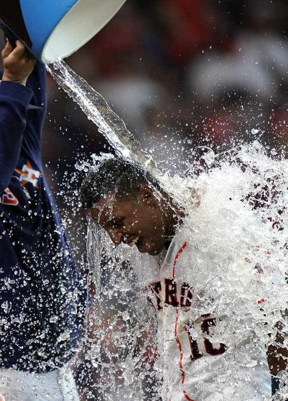 Houston Astros' Tony Kemp (18) is doused with water by Lance McCullers Jr. after hitting the game-winning home run against the Cleveland Indians during the 10th inning of a baseball game Saturday, April 27, 2019, in Houston. (AP Photo/David J. Phillip)