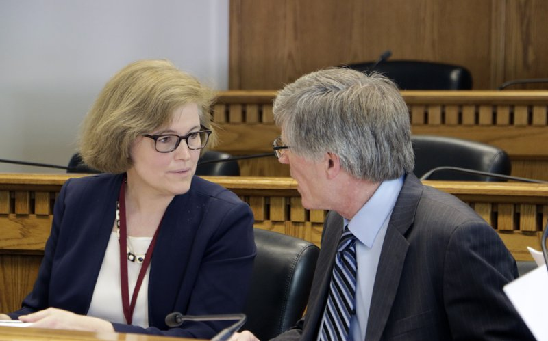 Sen. Christine Rolfes and Rep. Timm Ormsby talk before the start of a meeting to sign a conference committee report on a state budget plan, on Saturday, April 27, 2019, in Olympia, Wash. (AP Photo/Rachel La Corte)