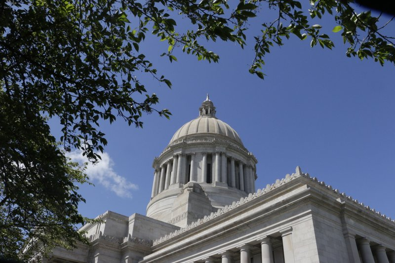 The Washington Capitol is seen on Saturday, April 27, 2019, in Olympia, Wash. State lawmakers are facing a midnight Sunday deadline to avoid going into overtime to pass a new, two-year state budget. (AP Photo/Rachel La Corte)
