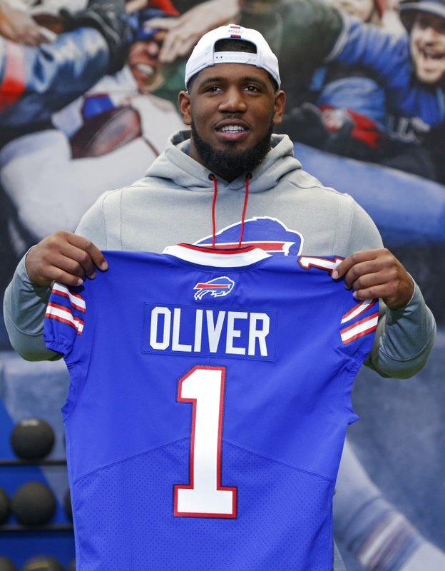 Buffalo Bills first-round draft pick Ed Oliver poses for photographs following an NFL football news conference Friday, April 27, 2019, in Orchard Park N. (AP Photo/Jeffrey T. Barnes)