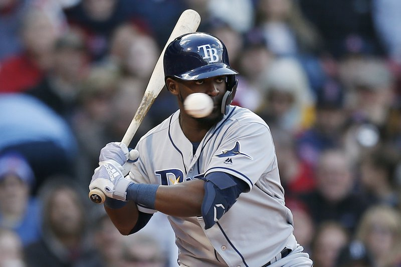 Tampa Bay Rays' Guillermo Heredia takes a ball during the fourth inning of a baseball game against the Boston Red Sox in Boston, Saturday, April 27, 2019. (AP Photo/Michael Dwyer)