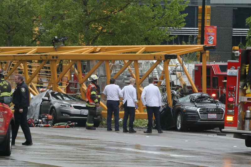 Emergency crews work at the scene of a construction crane collapse near the intersection of Mercer Street and Fairview Avenue near Interstate 5 Saturday, April 27, 2019, in Seattle. (Alan Berner/The Seattle Times via AP)