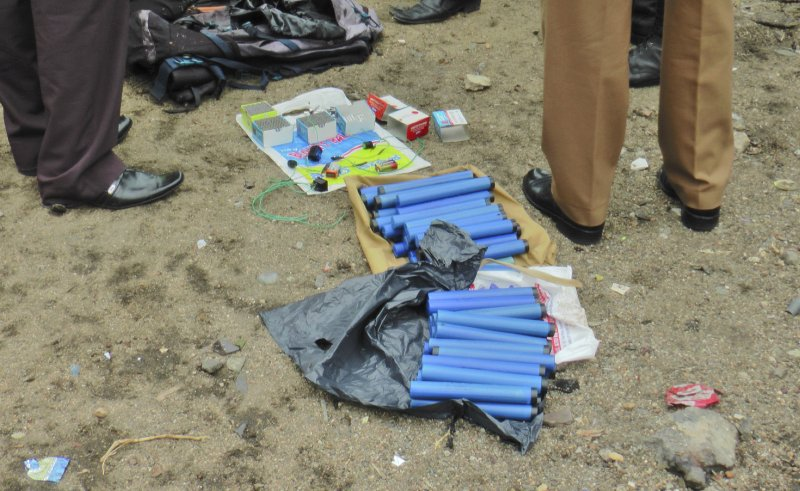 Sri Lankan police and army officers display gelatin sticks, and other bomb making materials recovered from the hide out of militants after Friday's gun battle in Kalmunai, in eastern Sri Lanka Sri Lanka, Saturday, April 27, 2019. (AP Photo/Achala Upendra)