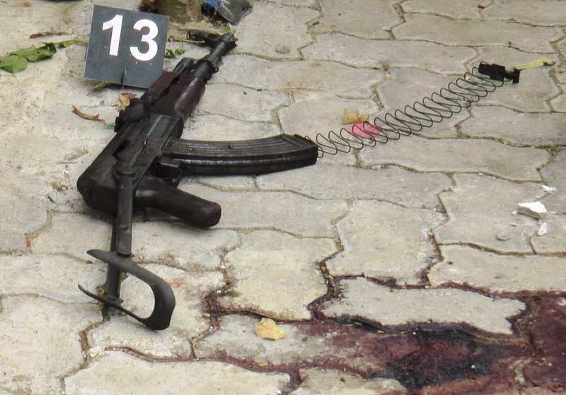 An AK47 rifle is seen lying at the place where an alleged terrorist was shot during a gunbattle in Kalmunai, in eastern Sri Lanka, Saturday, April 27, 2019. (AP Photo/Achala Upendra)