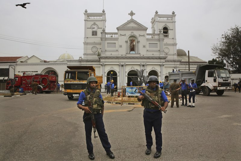 Sri Lankan Naval soldiers stand outside damaged St. Anthony's Church, in Colombo, Saturday, April 27, 2019. (AP Photo/Manish Swarup)