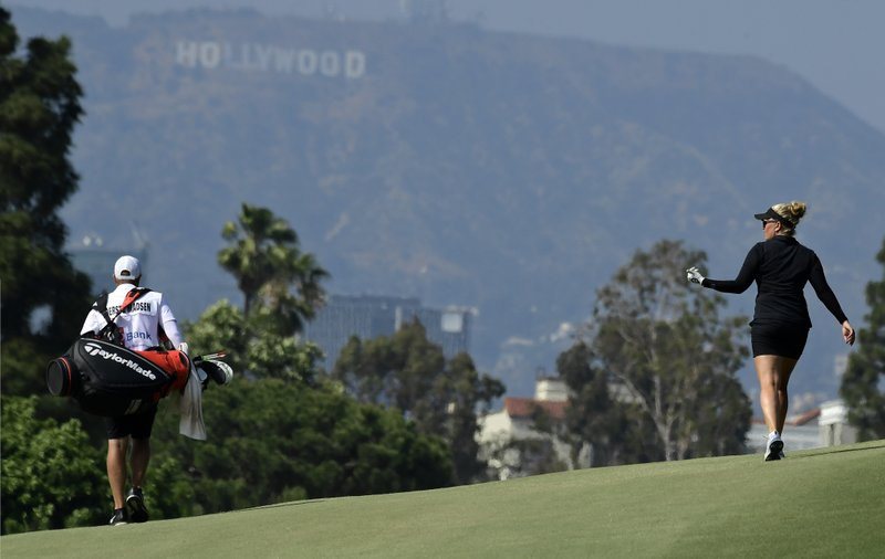 Nanna Koerstz Madsen, right, of Denmark, talks to her caddie as she walks up the ninth fairway during the third round of the Hugel-Air Premia LA Open golf tournament at Wilshire Country Club, Saturday, April 27, 2019, in Los Angeles. (AP Photo/Mark J. Terrill)