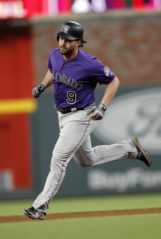 Colorado Rockies' Daniel Murphy rounds the bases after hitting a solo home run in the fourth inning of a baseball game against the Atlanta Braves, Saturday, April 27, 2019, in Atlanta. (AP Photo/John Bazemore)