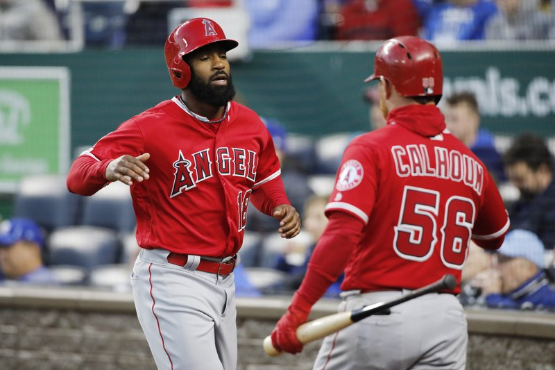 Los Angeles Angels' Brian Goodwin (18) is congratulated by Kole Calhoun (56) after scoring off a Tommy La Stella single in the fourth inning against the Kansas City Royals at Kauffman Stadium in Kansas City, Mo. (AP Photo/Colin E. Braley)