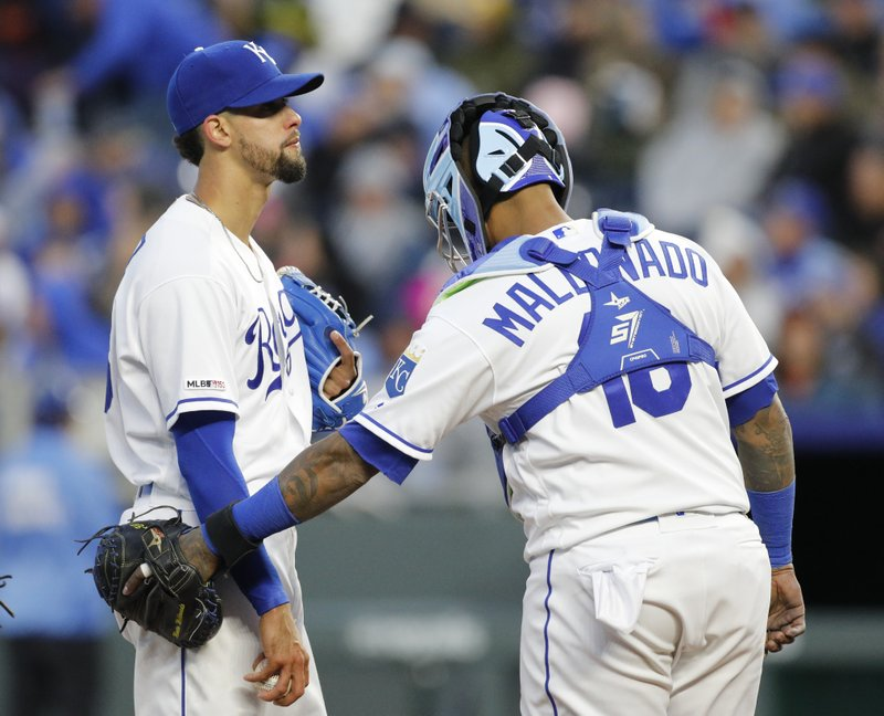 Kansas City Royals pitcher Jorge Lopez, left, reacts as he is consoled by catcher Martin Maldonado (16) after loading the bases in the fourth inning of a baseball game against the Los Angeles Angels at Kauffman Stadium in Kansas City, Mo. (AP Photo/Colin E. Braley)