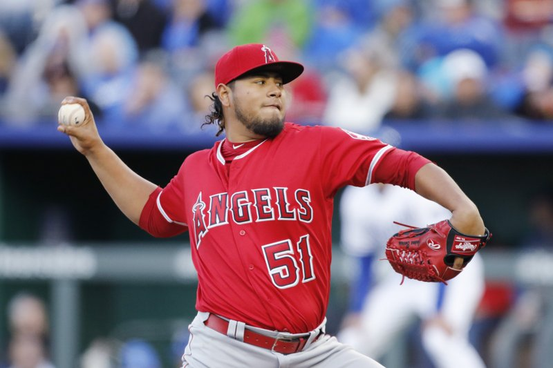 Los Angeles Angels pitcher Jaime Barria throws in the second inning of a baseball game against the Kansas City Royals at Kauffman Stadium in Kansas City, Mo. (AP Photo/Colin E. Braley)