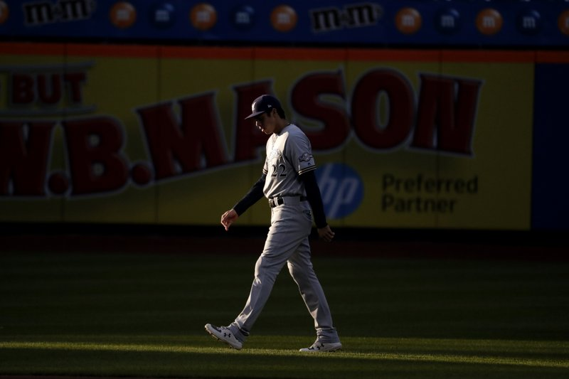 Milwaukee Brewers right fielder Christian Yelich walks on the field prior to a baseball game against the New York Mets, Saturday, April 27, 2019, in New York. (AP Photo/Julio Cortez)