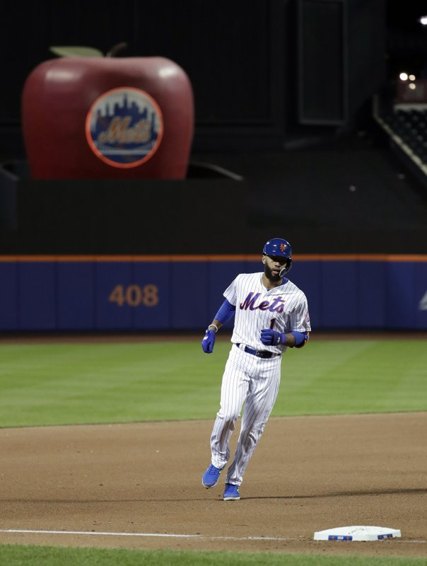 New York Mets' Amed Rosario runs the bases after hitting a solo home run off Milwaukee Brewers relief pitcher Alex Wilson during the seventh inning of a baseball game, Saturday, April 27, 2019, in New York. (AP Photo/Julio Cortez)