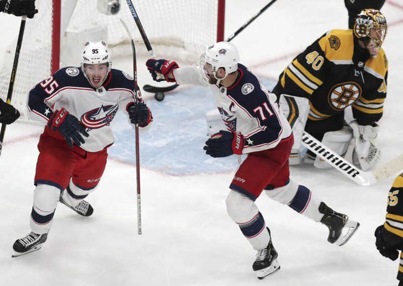 Columbus Blue Jackets center Matt Duchene, left, celebrates with Nick Foligno (71) after his game-winning goal against Boston Bruins goaltender Tuukka Rask (40) during double overtime of Game 2 of an NHL hockey second-round playoff series, early Sunday, April 28, 2019, in Boston. (AP Photo/Charles Krupa)