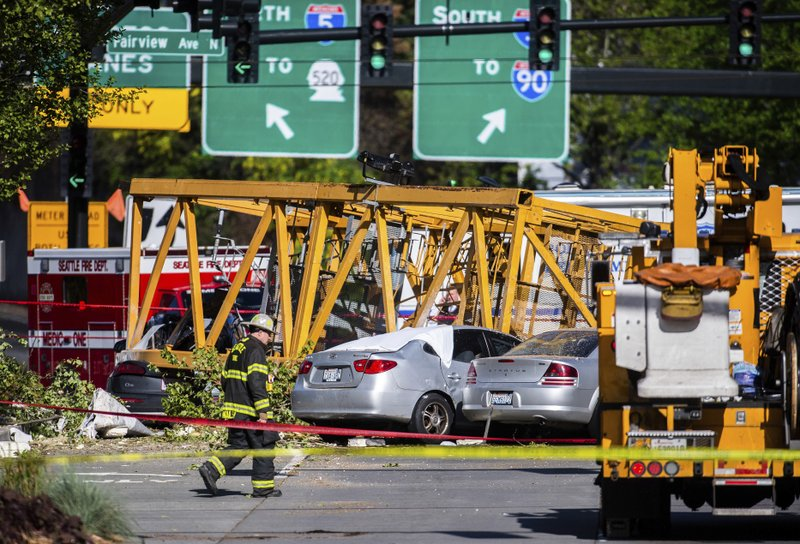 Emergency crews work the scene of a construction crane collapse near the intersection of Mercer Street and Fairview Avenue near Interstate 5 in Seattle, on Saturday, April 27, 2019. (Joshua Bessex/The News Tribune via AP)