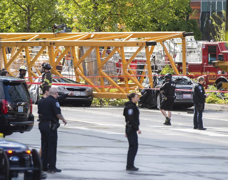 Emergency crews work the scene of a construction crane collapse at the intersection Mercer Street and Fairview Avenue near Interstate 5 in downtown Seattle, on Saturday, April 27, 2019. (Joshua Bessex/The News Tribune via AP)