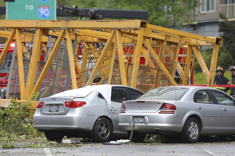 A construction crane working on a building collapsed on Mercer Street near Interstate 5, Saturday, April 27, 2019, in Seattle. (Genna Martin/seattlepi.com via AP)