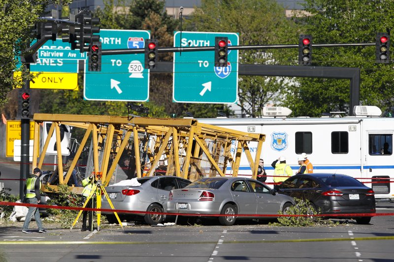 Emergency crews work at the scene of a construction crane collapse where several people were killed and others injured Saturday, April 27, 2019, in the South Lake Union neighborhood of Seattle. (AP Photo/Joe Nicholson)