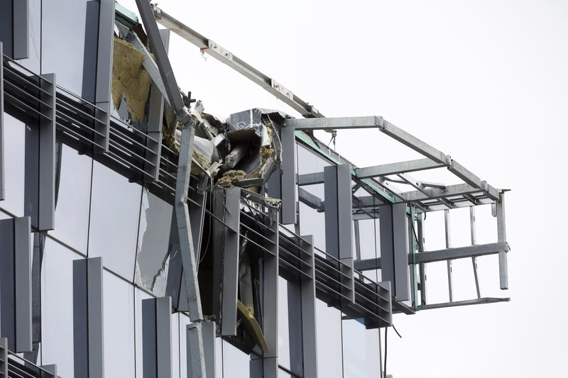 A construction crane working on a building on Mercer Street collapsed, Saturday, April 27, 2019, in downtown Seattle. (Genna Martin/seattlepi.com via AP)