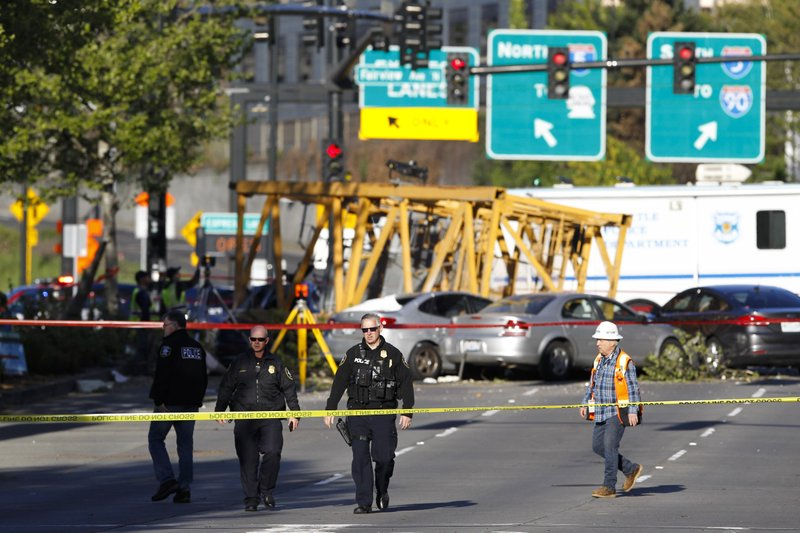 Emergency crews work at the scene of a construction crane collapse where several people were killed and others were injured Saturday, April 27, 2019, in the South Lake Union neighborhood of Seattle. (AP Photo/Joe Nicholson)
