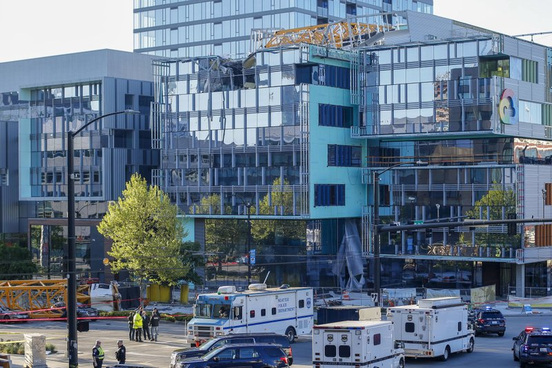 Emergency crews work at the scene of a construction crane collapse where several people were killed and several others injured Saturday, April 27, 2019, in the South Lake Union neighborhood of Seattle. (AP Photo/Joe Nicholson)
