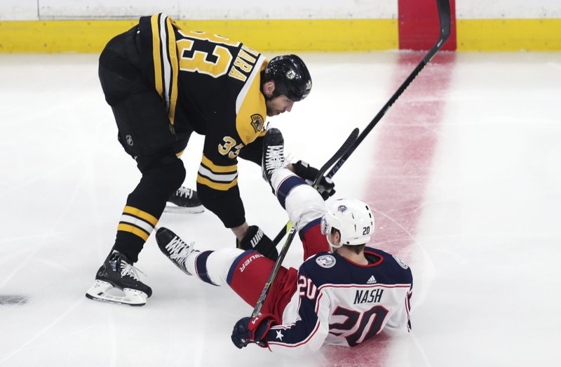 Boston Bruins defenseman Zdeno Chara (33) drops Columbus Blue Jackets center Riley Nash (20) to the ice during the first period of Game 2 of an NHL hockey second-round playoff series, Saturday, April 27, 2019, in Boston. (AP Photo/Charles Krupa)