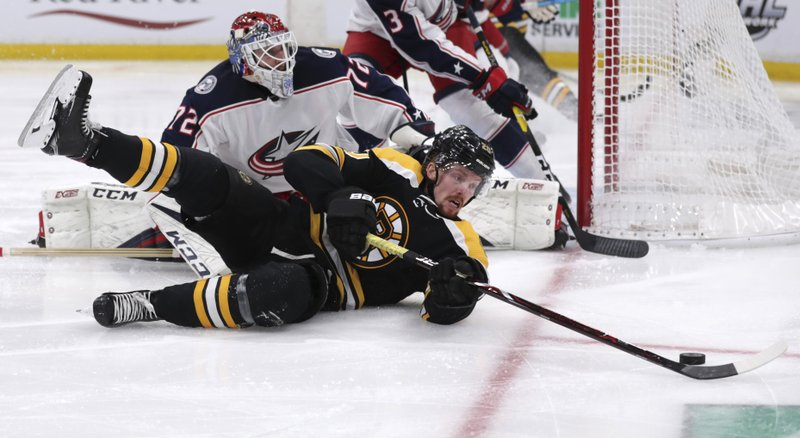 Boston Bruins center Joakim Nordstrom (20) tries to control the puck after a save by Columbus Blue Jackets goaltender Sergei Bobrovsky (72) during the second period of Game 2 of an NHL hockey second-round playoff series, Saturday, April 27, 2019, in Boston. (AP Photo/Charles Krupa)