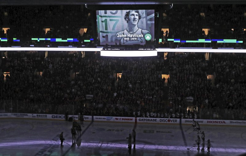 Boston Celtics legend John Havlicek, who died this past week, is honored with a moment of silence prior to Game 2 of an NHL hockey second-round playoff series game between the Boston Bruins and Columbus Blue Jackets, Saturday, April 27, 2019, in Boston. (AP Photo/Charles Krupa)