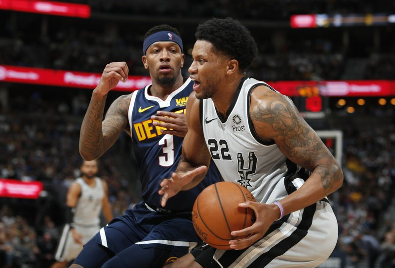 San Antonio Spurs forward Rudy Gay, front, drives to the basket past Denver Nuggets forward Torrey Craig in the first half of Game 7 of an NBA basketball first-round playoff series Saturday, April 27, 2019, in Denver. (AP Photo/David Zalubowski)