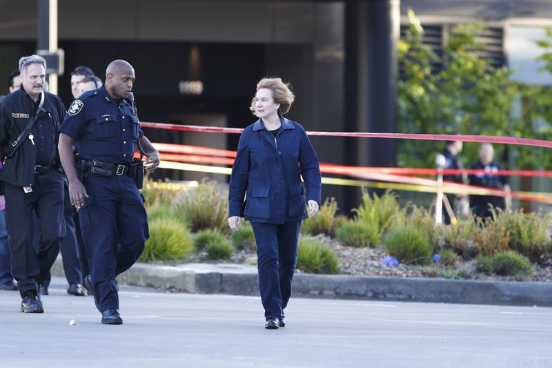Seattle Mayor Jenny Durkan, right, walks at the scene of a construction crane collapse where several people were killed and several others injured Saturday, April 27, 2019, in the South Lake Union neighborhood of Seattle. (AP Photo/Joe Nicholson)