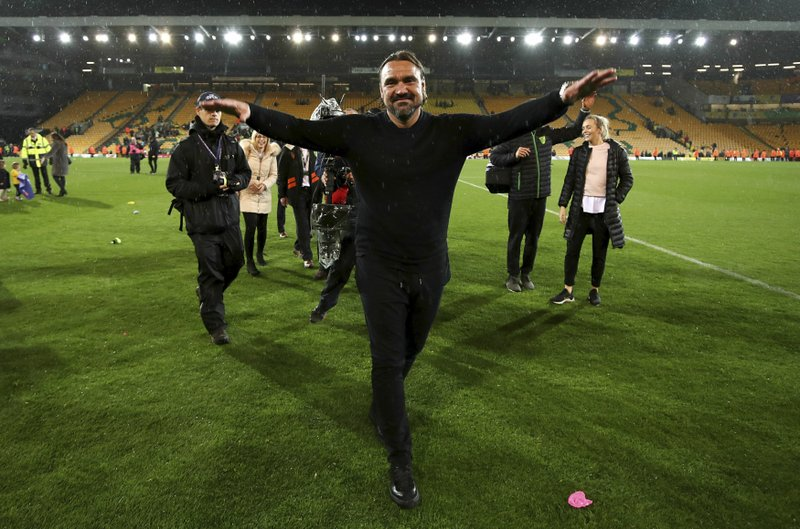 Norwich City manager Daniel Farke celebrates promotion to the Premier League after the English Championship soccer match against Blackburn Rovers at Carrow Road, Norwich, England, Saturday April 27, 2019. (Chris Radburn/PA via AP)