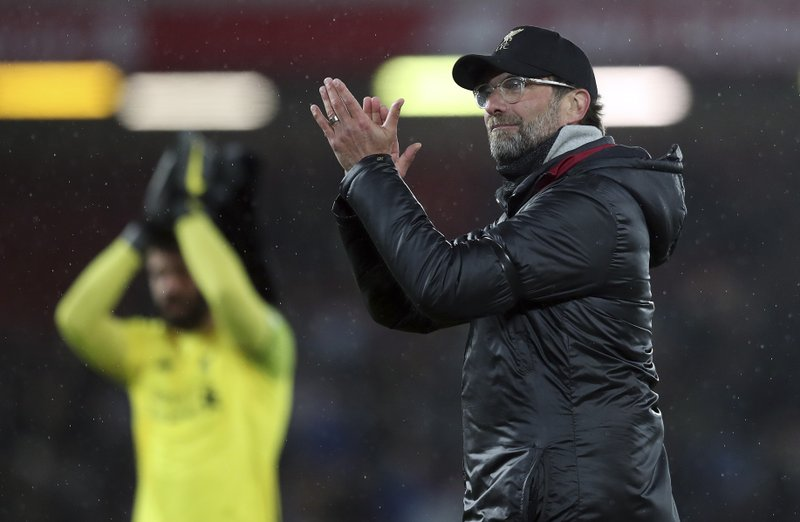 Liverpool's coach Juergen Klopp celebrates after his team won the English Premier League soccer match between Liverpool and Huddersfield Town at Anfield Stadium, in Liverpool, England, Friday, April 26, 2019.(AP Photo/Jon Super)