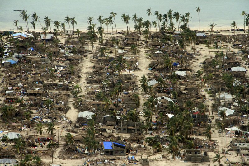 In this photo provided by the United Nations Office for the Coordination of Humanitarian Affairs (OCHA), badly damaged communities are seen from an aerial view, in Macomia district, Mozambique, on Saturday, April 27, 2019. (Saviano Abreu/OCHA via AP)