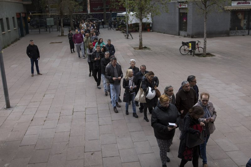 People line up outside a polling station to cast their vote for the general election in Barcelona, Spain, Sunday, April 28, 2019. (AP Photo/Emilio Morenatti)