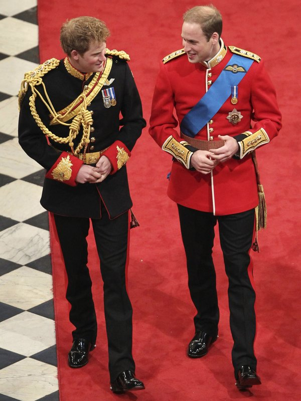 FILE - In this Friday, April 29, 2011 file photo, Britain's Prince Harry, left, best man to Britain's Prince William, right, arrive ahead of Prince William's marriage to Kate Middleton at Westminster Abbey, London. (/Andrew Milligan, Pool Photo via AP, File)