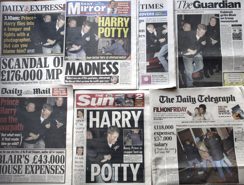 FILE - In this Friday, Oct. 22, 2004 file photo, a montage of the front pages of Britain's national newspapers  where photos of Prince Harry's altercation with a photographer outside a central London night spot, in the early hours of Thursday morning, dominated. (AP Photo/Adam Butler, File)