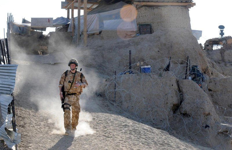 FILE In this Jan. 2, 2008 file photo, Britain's Prince Harry on patrol through the deserted town of Garmisir close to FOB (forward operating base) Delhi, where he was posted in Helmand province Southern Afghanistan. (John Stillwell, Pool Photo via AP, File)