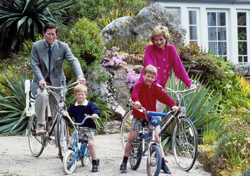 FILE - In this June 1, 1989 file photo, Britain's Prince Charles and Princess Diana and their sons, Princes William, right, and Harry begin a cycle ride, around the island of Tresco, one of the Scilly Isles,  located off the southwest tip of Britain. (AP Photo, File)