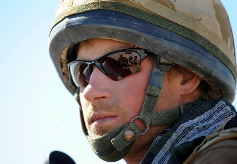 FILE - In this Feb. 18, 2008 file photo, Britain's Prince Harry, sits atop a military vehicle in the Helmand province, Southern Afghanistan. (John Stillwell, Pool Photo via AP, File)