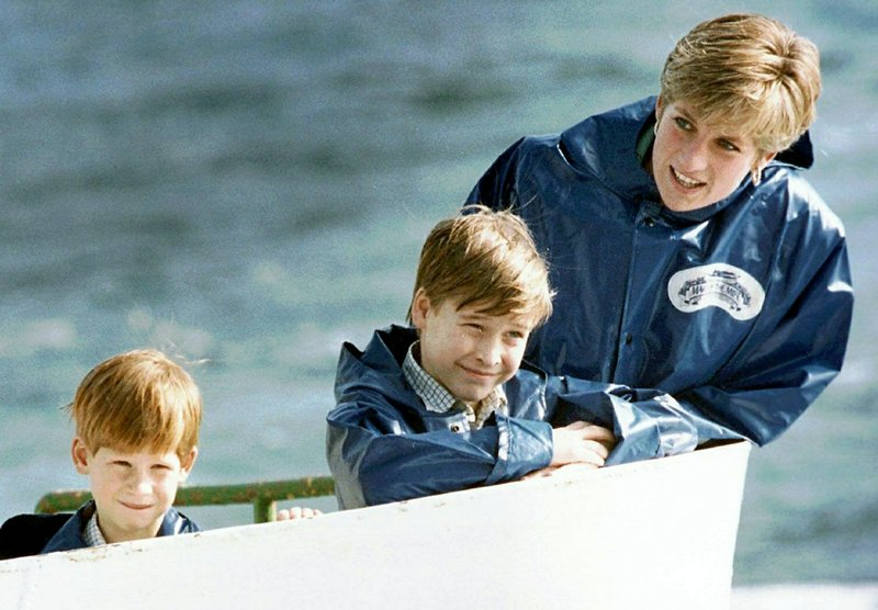 FILE - In this Oct. 1991 file photo, Britain's Diana, Princess of Wales, right, enjoys a boat ride on the Maid of Mist in Niagara Falls, Ont. (Hans Deryk/Canadian Press via AP, File)