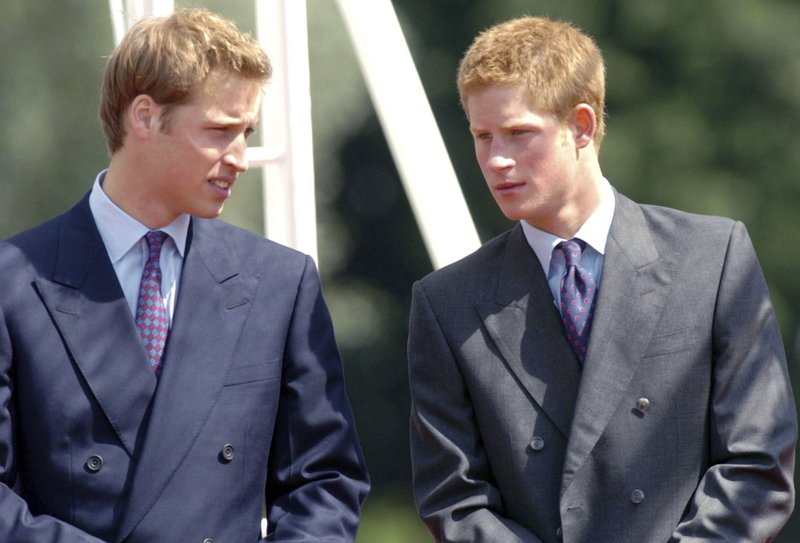 FILE - In this Tuesday, July 6, 2004 file photo, Britain's Princes William, left, and Harry talk at the opening of a fountain built in memory of their mother, the late Princess of Wales, in London's Hyde Park. (Arthur Edwards, Pool Photo via AP, File)