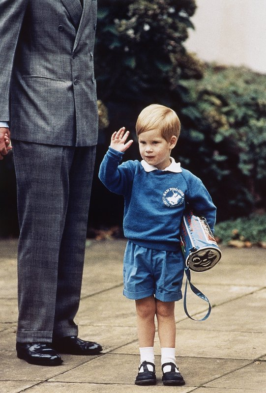 FILE - In this Sept. 16, 1987 file photo, Britain's Prince Harry waves to photographers on his first day at a kindergarten in Notting Hill, West London. (AP Photo/Martin Cleaver, File)