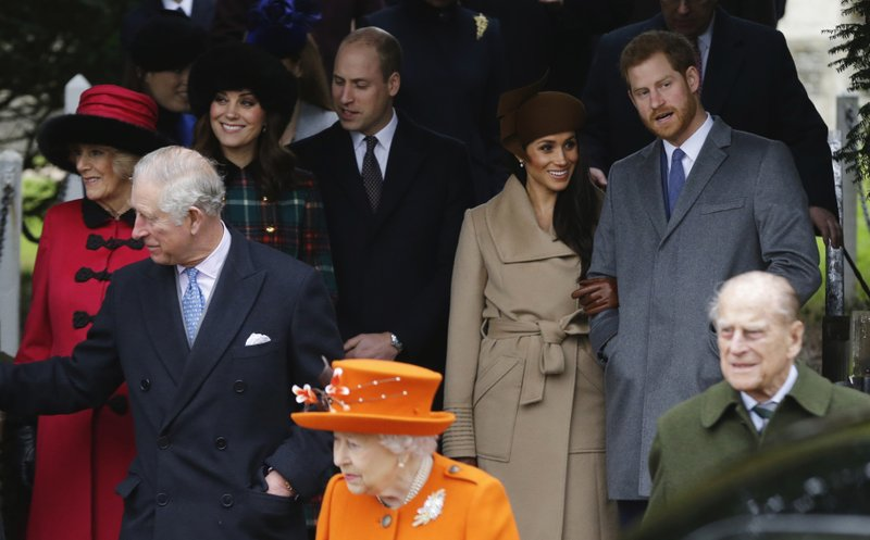 FILE - In this Monday, Dec. 25, 2017 file photo, front from left: Britain's Prince Charles, Queen Elizabeth II and Prince Philip. (AP Photo/Alastair Grant, File)