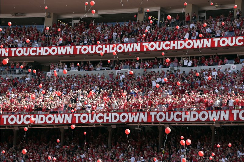 FILE - In this Sept. 15, 2018, file photo, Nebraska fans release red balloons after a touchdown against Troy during the first half of an NCAA college football game in Lincoln, Neb. (AP Photo/Nati Harnik, File)