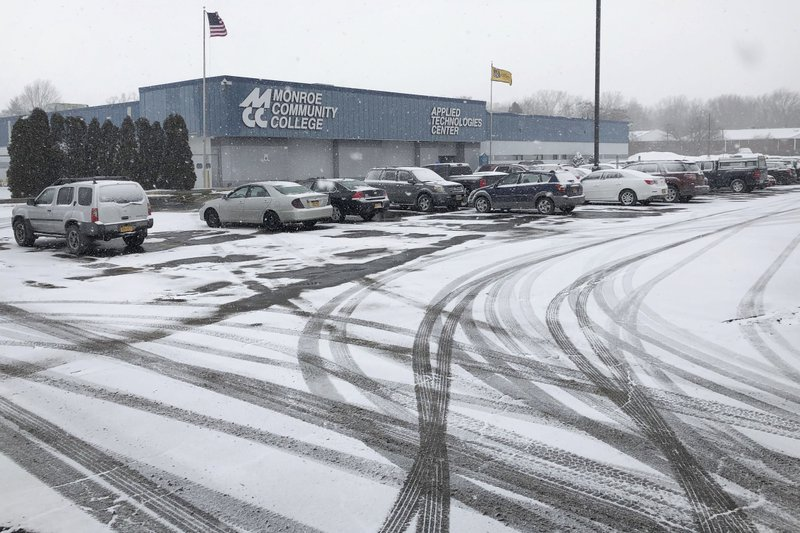 Snow falls at Monroe Community College in Rochester, N.Y., on Wednesday, March 6, 2019. One of the suspects in an alleged terrorism plot, Vincent Vetromile, attended the school about a year before his arrest. (AP Photo/Adam Geller)