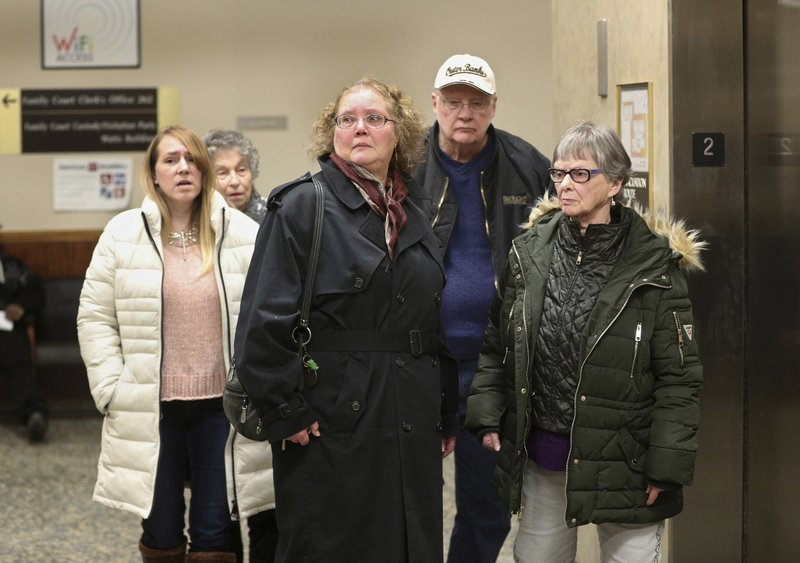 Family and friends of Brian Colaneri, including his mother, April, center, leave court in Rochester, N. (Jamie Germano/Democrat & Chronicle via AP, Pool)