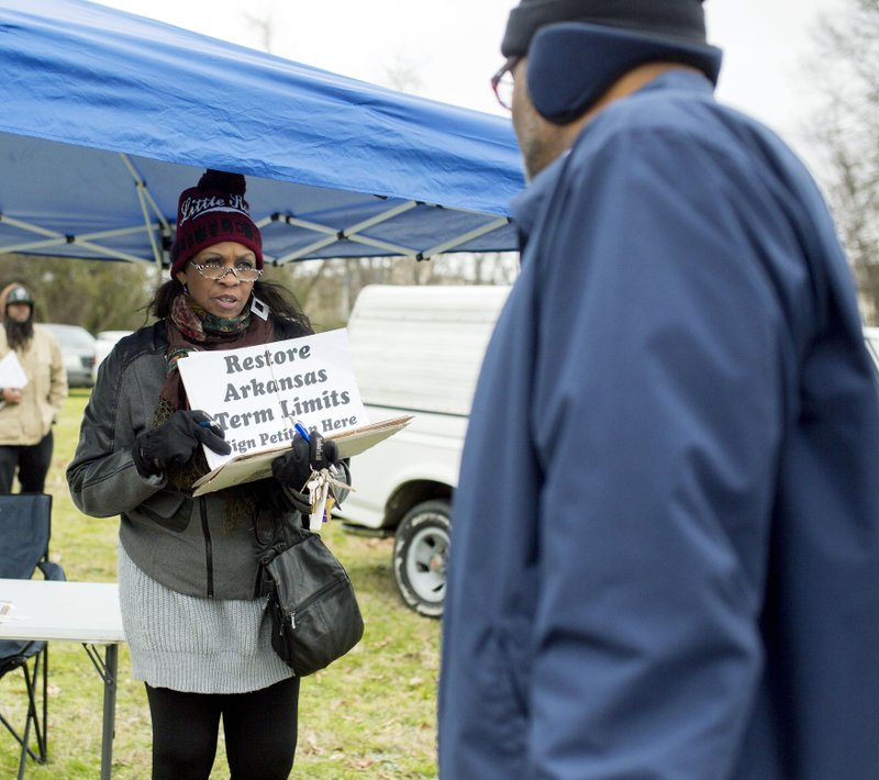 FILE - In this Jan. 18, 2016 file photo, Nanette Edgeston-Green, right, gathers signatures on a petition to restore lawmakers term limits in Little Rock, Ark. (AP Photo/Gareth Patterson, File)
