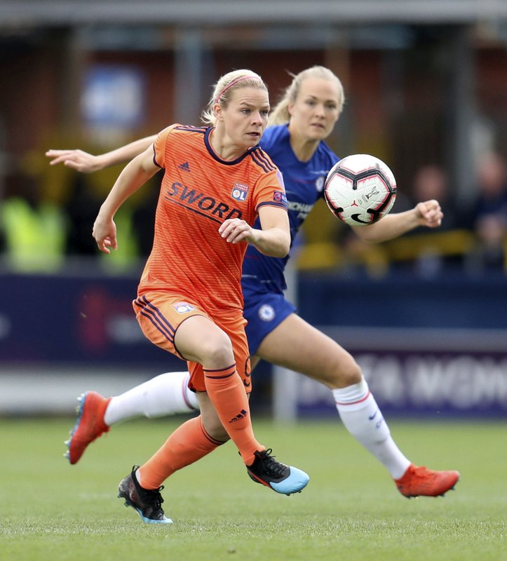 Lyon's Eugenie Le Sommer, front, in action with Chelsea's Magdalene Ericsson during the UEFA Women's Champions League semi final second leg soccer match at the Cherry Red Records Stadium, London, Sunday, April 28, 2019. (Bradley Collyer/PA via AP)