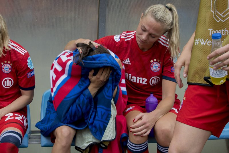 Bayern Munich players react at the end of the Women's Champions League semifinal second leg soccer match between FC Barcelona and Bayern Munich at the Miniestadi stadium in Barcelona, Spain, Sunday, April 28, 2019. (AP Photo/Joan Monfort)