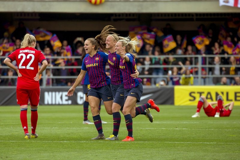 FC Barcelona players celebrate at the end of the Women's Champions League semifinal second leg soccer match between FC Barcelona and Bayern Munich at the Miniestadi stadium in Barcelona, Spain, Sunday, April 28, 2019. (AP Photo/Joan Monfort)
