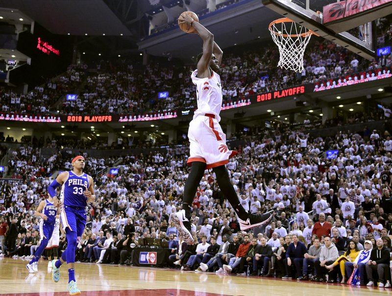 Toronto Raptors forward Pascal Siakam (43) dunks the ball as Philadelphia 76ers forward Tobias Harris (33) tries to catch up during the second half of Game 1 of a second round NBA basketball playoff series, in Toronto on Saturday, April 27, 2019. (Frank Gunn/The Canadian Press via AP)